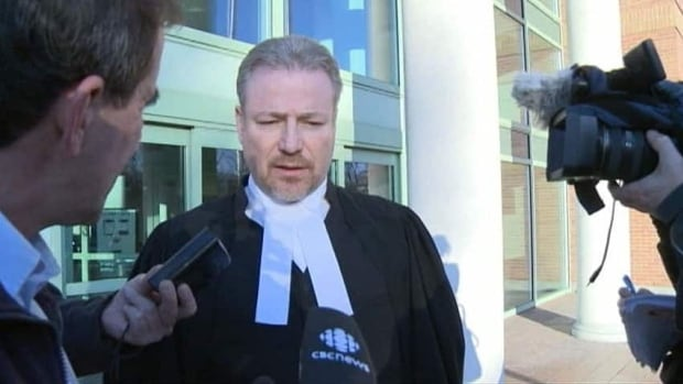 Neil Snelson's defence lawyer, Wade Jenson talks to reporters after Snelson was convicted in 2011.