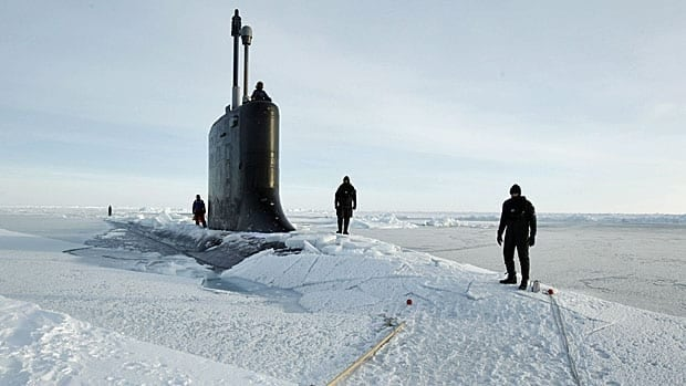 U.S. Navy divers on the deck of the USS New Hampshire after it surfaced in the Arctic Ocean north of Prudhoe Bay, Alaska, in March 2011. (Lucas Jackson/Reuters)