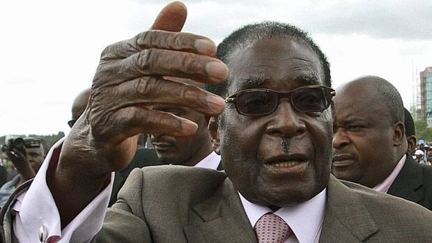 Zimbabwe's President Robert Mugabe gestures as he leaves a rally on March 2. With an election looming, he has mounted an intense campaign to discredit political rivals and Western critics of his authoritarian rule.