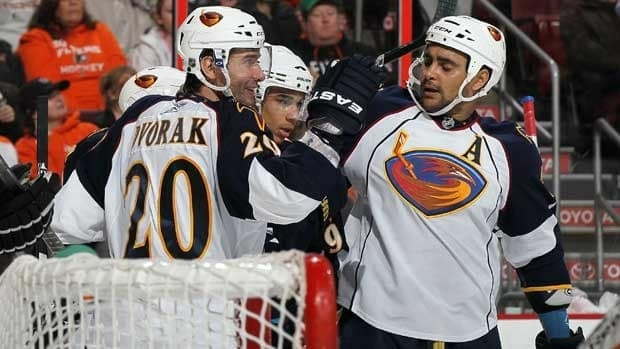 Thrashers forward Dustin Byfuglien, right, began his junior hockey career in Brandon, Man., near Winnipeg.