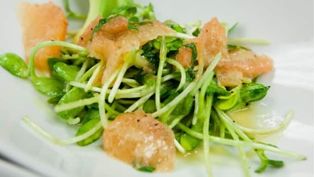 A salad of sunflower sprouts, grapefruit and avocado.