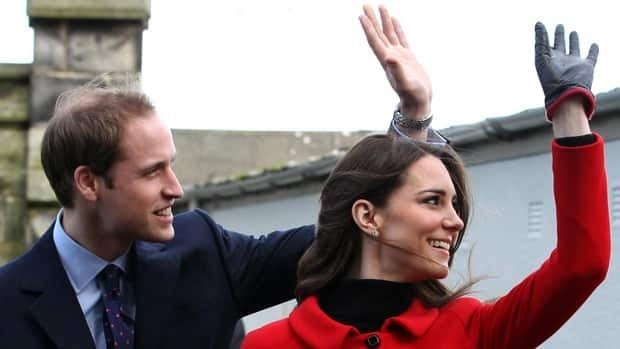 Prince William and Kate Middleton wave during a visit to St Andrews University in Scotland on Feb. 25.