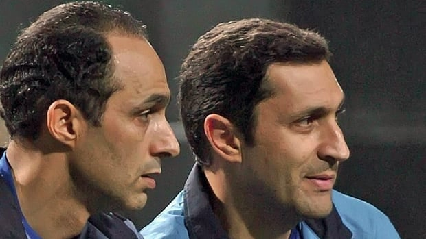 Gamal Mubarak, left, and his brother Alaa Mubarak, seen in this August 2008 photo, have more than $300 million in Swiss bank accounts, Egyptian official alledge.
