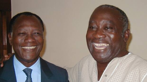 Laurent Gbagbo, right, and Alassane Ouattara smile together on Oct. 27, 2000, in Gbagbo's villa in Abidjan, Ivory Coast, where they held talks shortly after Gbagbo took office. After the talks, Ouattara told reporters his Rally of the Republicans party would not be entering the government.