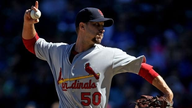 Adam Wainwright's two-year, $21 million US option was picked up by the St. Louis Cardinals on Thursday.