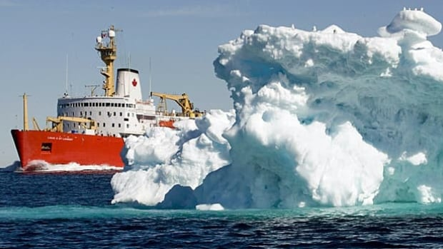 The Canadian Coast Guard icebreaker Louis S. St-Laurent sails past a iceberg in Lancaster Sound on July 11, 2008. The icebreaker was on its annual voyage through Canada's Arctic that includes patrols through the Northwest Passage.
