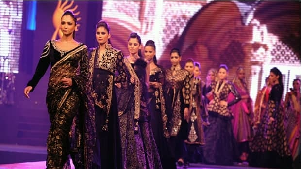 Indian models walk the catwalk at the IIFA Rocks fashion show, prior to the International Indian Film Academy (IIFA) awards ceremony in Colombo, Sri Lanka, in 2010.