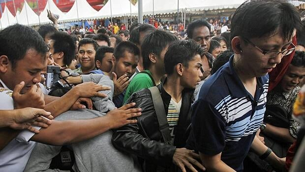 People scramble during the global launch of the BlackBerry Bold 9790, also known as the BlackBerry Bellagio, at a mall in Jakarta, Indonesia on Friday.