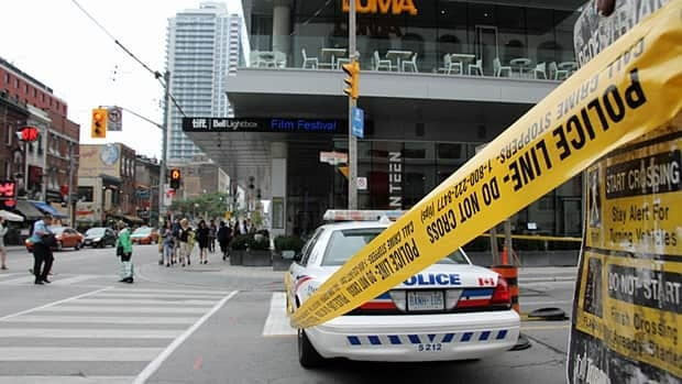 Police cordoned off a short section of John Street north of King Street after glass fell from a building on Tuesday night. The section of John Street remained closed on Wednesday afternoon.