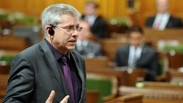 New Democratic Party MP Charlie Angus speaks in the House of Commons as his party continues their filibuster on the government back-to-work legislation on Parliament Hill in Ottawa. The House gave third reading to the bill just after 8 p.m. by a vote of 158-113.