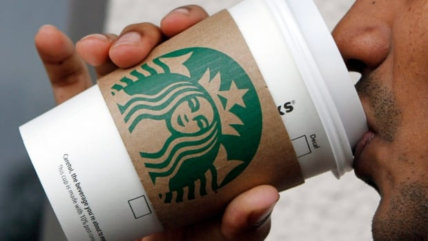 A customer sips a Starbucks coffee in this photo taken in Miami in 2011. Starbucks CEO Howard Schultz is this week urging Washington to end the government shutdown and the company is offering a petition to its customers.