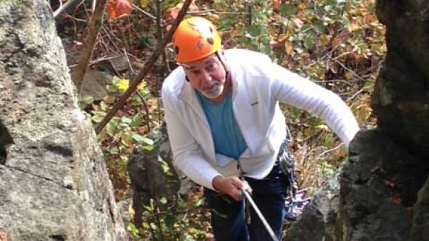 Thunder Bay Mayor Keith Hobbs tries out rock climbing during a visit by Gripped magazine staff members.