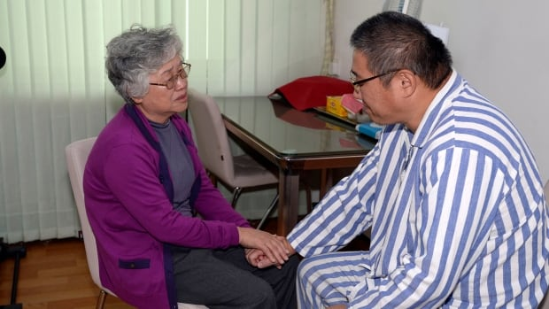 Kenneth Bae, an American Christian missionary who ran a tour business in North Korea, greets his mother in the Pyongyang hospital where he is serving a 15-year prison sentence. An ailing Bae was moved to the hospital from a work camp after loosing 50 lbs.
