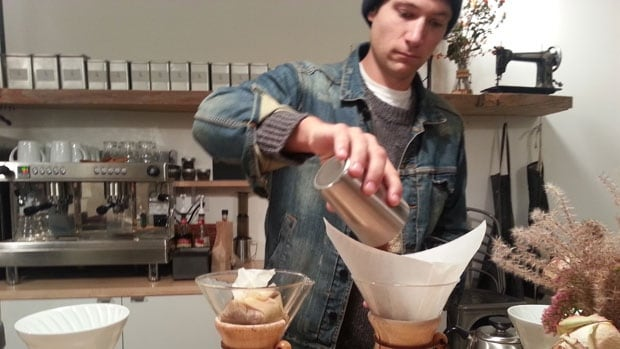 Graham Bargen, owner of coffee shop Thom Bargen, prepares coffee for CBC's contest. The winner is Little Sister at 470 River Avenue in Winnipeg.