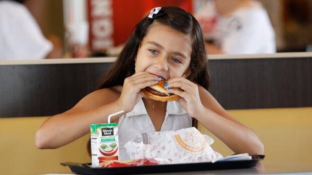 Paolo Beldran eats a healthy choice meal at Burger King.