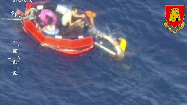 Migrants are seen aboard a life raft after a boat carrying an estimated 200 people capsized off the Sicilian island of Lampedusa on Friday.