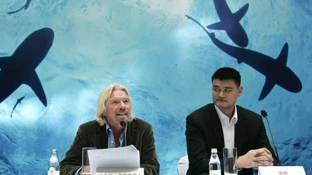 Recently retired Chinese NBA star Yao Ming, right, and British tycoon Richard Branson attend a press conference for a campaign against eating shark fins in Shanghai on Thursday.