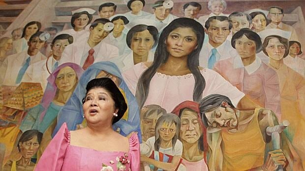 Former Philippine first lady and now congresswoman Imelda Marcos speaks in front of a mural titled Inang Bayan (Motherland) dedicated to her by artist Vicente Manansala during a ceremony at the Philippine Heart Centre in Quezon City, Metro Manila, Feb. 28.