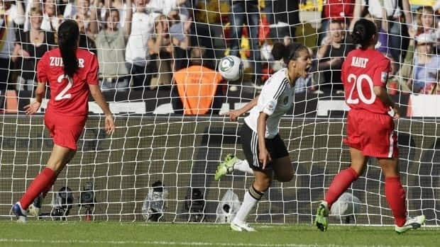 Germany's Celia Okoyino da Mbabi celebrates after scoring against Canada on Sunday.