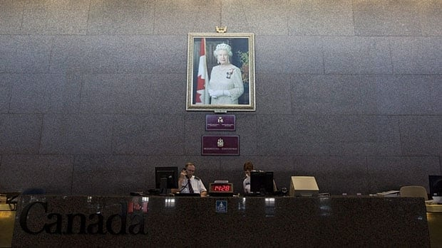 A portrait of the Queen hangs on the Sovereign's Wall at the Department of Foreign Affairs in Ottawa. The Conservative government has ordered all Canadian embassies to display the portrait.