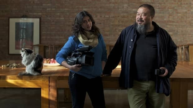 Filmmaker Alison Klayman and the Chinese conceptual artist Ai Weiwei in his Beijing studio. Ai was arrested April 3 by Chinese authorities and little information has been released since about his whereabouts or the reason for his detention. Klayman has made a film about Ai titled Ai Weiwei: Never Sorry.