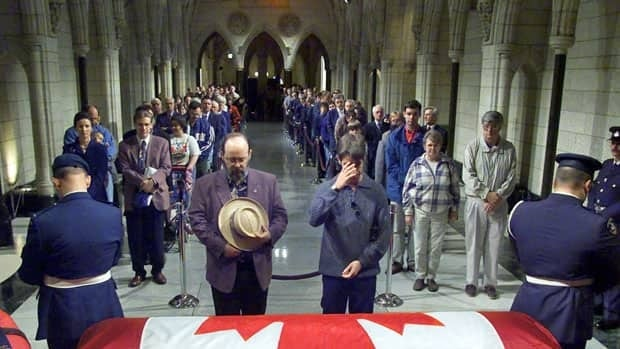 A constant stream of mourners file past the flag-draped casket of former prime minister Pierre Elliott Trudeau in the hall of honour of Parliament in Ottawa, on Oct.1, 2000. The body of NDP Leader Jack Layton will lie in state in Ottawa Aug. 24 and 25.