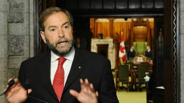 NDP House leader Thomas Mulcair speaks to reporters outside the House of Commons before debate begins to limit the amount of time MPs will have for consideration of the Conservatives' omnibus crime legislation.