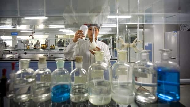 In this Oct. 16, 2008 file photo, a Chinese worker checks ingredients in milk products in a lab of Yili Industrial Group Co., one of China's largest dairy producers. China's food industry still suffers from the use of dangerous illegal additives.
