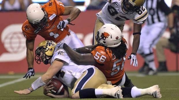 Quarterback Buck Pierce, bottom, and the Winnipeg offence couldn't keep up with their B.C. counterparts in the Grey Cup Game.