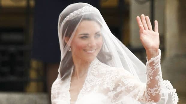 Kate Middleton arrives at Westminster Abbey for her wedding ceremony on Friday wearing an ivory and white gown made of satin gazar and two kinds of lace and designed by Sarah Burton from the fashion house of the late British designer Alexander McQueen. The design of her dress had been the subject of much speculation ahead of the wedding.