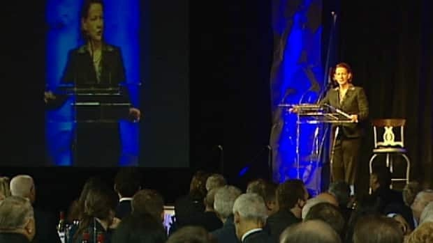 Premier Alison Redford speaks to a Conservative party fundraising dinner in Red Deer Thursday. She promised to look into reports of municipalities making illegal donations to the party.