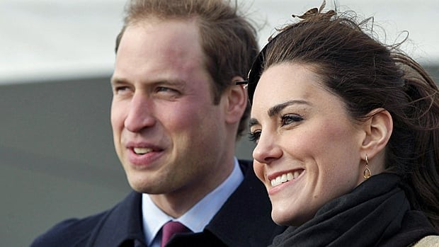 Prince William and Kate Middleton react following a naming ceremony for the Royal National Lifeboat Institution's new Atlantic 85 Lifeboat at Trearddur Bay Lifeboat Station in Anglesey, Wales, on Feb. 24.
