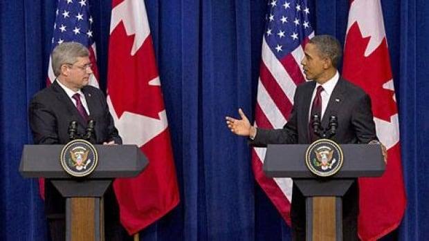 Prime Minister Stephen Harper, left and U.S. President Barack Obama hold a joint press conference in Washington, DC, Friday Feb. 4, 2011. (THE CANADIAN PRESS/Sean Kilpatrick)