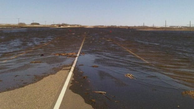 Water was running over the Trans-Canada Highway near Wolseley, Sask. on Tuesday.