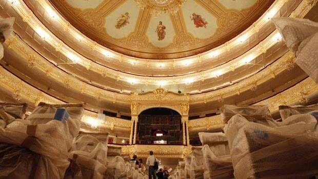 The Bolshoi restoration includes gold leaf meticulously layered on carved mouldings, glistening light fixtures and seats re-covered in plush red velour.