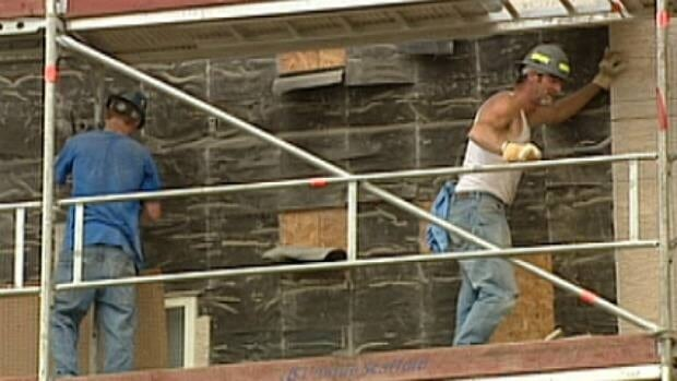 Workers are resealing the exterior walls of the eight-year-old Glenora Gates condo building.