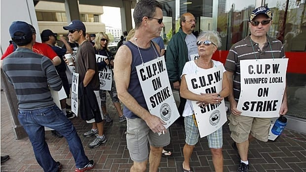Members of the Canadian Union of Postal Workers picket in front of a the main post office on Graham Avenue in Winnipeg on June 3, 2011.
