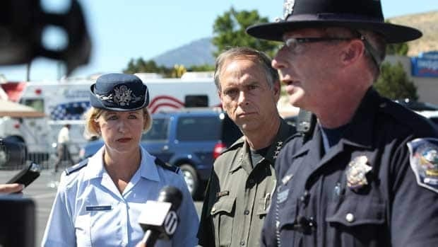 Nevada National Guard press information officer April Conway, left, and Sheriff Ken Furlong, centre, listen to Trooper Chuck Allen at a briefing after a fatal shooting in an IHOP restaurant in Carson City, Nev., on Tuesday.