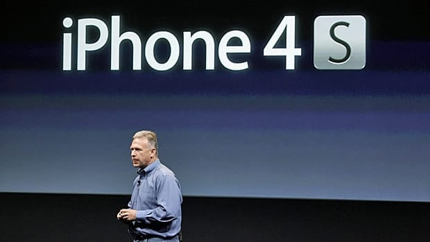 Apple's Phil Schiller talks about the iPhone 4S during an announcement at Apple headquarters in Cupertino, Calif., on Tuesday.