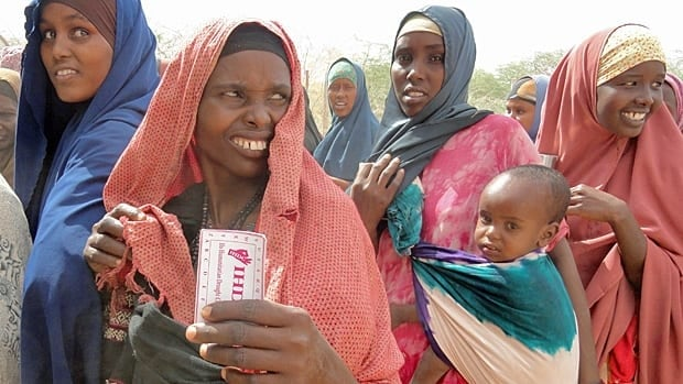 A Somali refugee in the Dadaab refugee camp in Kenya holds a ticket from the Turkish aid agency Yardimeli. The refugees traded the tickets for 2,000 Kenyan Shillings in cash, worth about $22 dollars.