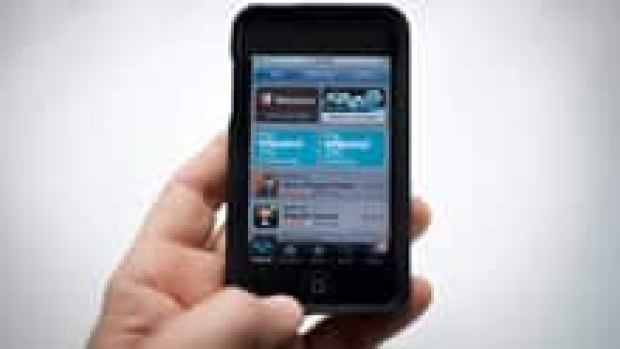 An iPod Touch is shown with the App Store on its screen. Apple is suing Amazon.com over what it says is trademark infringement and unfair competition for Amazon's use of the name 'Appstore.'