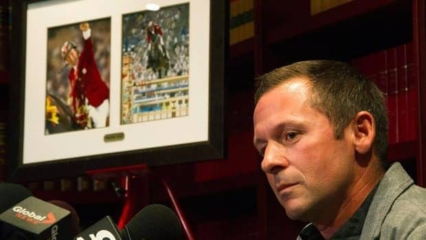 Canadian show jumper Eric Lamaze speaks to the media for the first time regarding the sudden death of his long time horse, Hickstead, in Toronto on Wednesday.