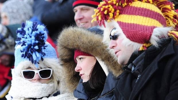 Fans bundle up for the cold during an outdoor hockey game in Calgary in February. Environment Canada climatologist David Phillips said most of the country will be colder than normal this winter because of La Nina.
