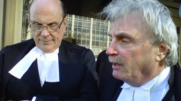 Defence lawyers Hymie Weinstein and Sheldon Pinx speak with reporters on the court steps Tuesday in Winnipeg.
