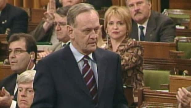 Then prime minister Jean Chrétien is applauded by his Liberal caucus in the House of Commons on March 17, 2003, after announcing Canada's refusal to partake in the U.S.-led invasion of Iraq.