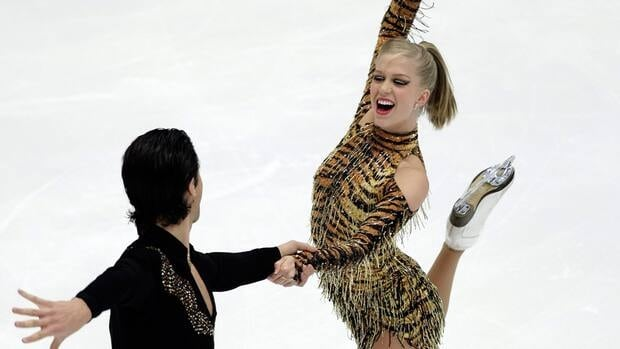 Kaitlyn Weaver, right, and partner Andrew Poje sat in second place after their short dance program Friday in Sapporo, Japan.