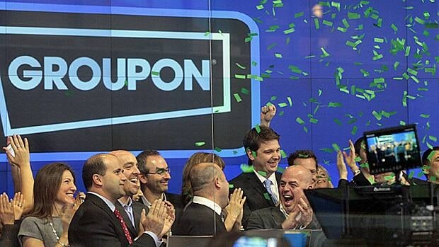 Employees of Groupon ring the opening bell in celebration of the company's IPO on the Nasdaq. GRPN shares soared in their debut.