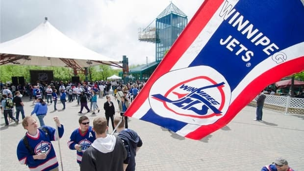 Hockey supporters rally at The Forks in Winnipeg on May 31, after the announcement that an NHL team will be returning to the city after 15 years.