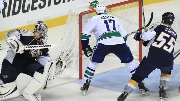 Vancouver Canucks centre Ryan Kesler (17) scores against Nashville Predators goalie Pekka Rinne, left, and defenceman Shane O'Brien (55) in the second period of Game 3 on Tuesday in Nashville, Tenn.