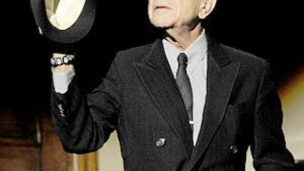Leonard Cohen acknowledges audience applause before a tribute concert at the Jovellanos Theatre in Gijon, Spain on Wednesday. He will receive the Prince of Asturias Award for Letters from Spain's Crown Prince Felipe in Oviedo on Friday.